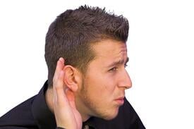 business man with hand on ear - what did you say?.jpeg